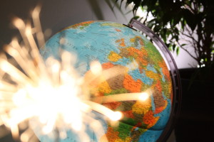 Picture of world globe and a glowing striker