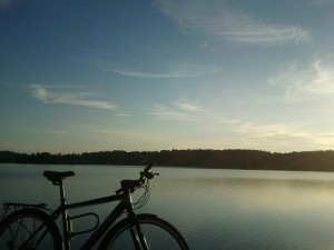 Picture of my bike by a lake with sunset