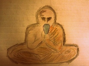 Picture of a monk sitting down meditating